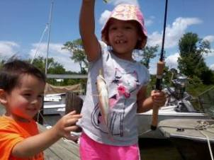 Allison and Aiden with Allison's first Perch. caught all by herself! Her brother wanted to touch it, too!